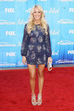 Carrie Underwood showed off her tan, toned pins in a blue Badgley Mischka mini back in May.
