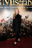 Amanda celebrated at the film's London afterparty in a polished coat and trouser set, finished with classic black pumps.