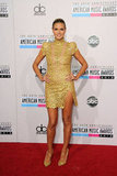 Heidi Klum wore a stunning Alexandre Vauthier gold lace minidress to the American Music Awards in November.