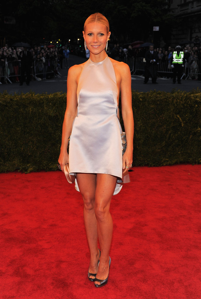 Gwyneth Paltrow dropped jaws in a sleek silver Prada mini at the Met Gala in May.
