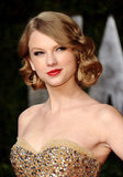 Taylor arrived at the 2011 Vanity Fair Oscar party in a glistening gown, which she opted to dress up with a polished faux bob and no-fail red lips. Her classic beauty look felt polished and showed off the sweetheart neckline of her dress.