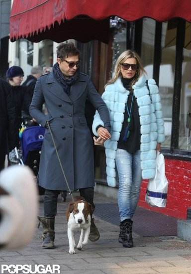 Kate Moss and Jamie Hince were arm in arm for a stroll with their dog in London.