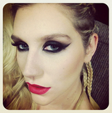 Ke$ha rocked a red lip and cat eye for an event. Source: Instagram user iiswhoiis
