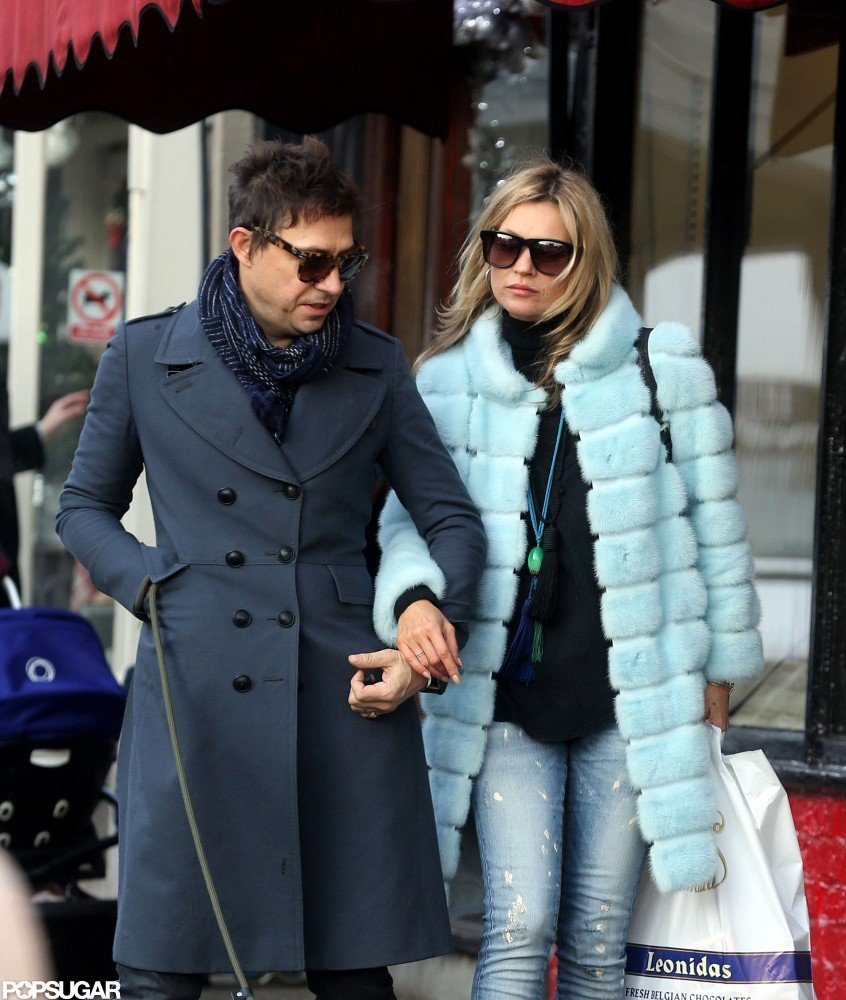 Kate Moss and Jamie Hince held hands as they took their dog for a walk.