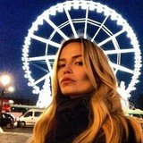 Natasha Poly posed near a Ferris wheel. Source: Instagram user natashapoly