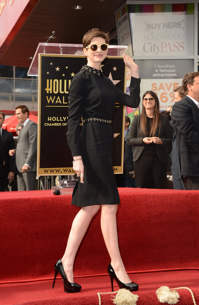 Anne Hathaway gave a wave.