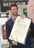 Hugh Jackman held up his certificate.