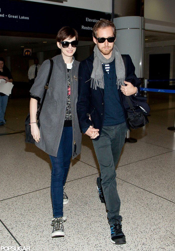 Anne Hathaway held hands with her husband.