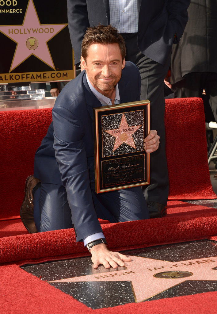 Hugh Jackman posed near his star on the Hollywood Walk of Fame.