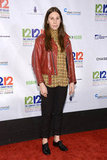 Girls' Zosia Mamet added interest to oxfords and trousers with a kaleidoscope-print blouse and a leather jacket.