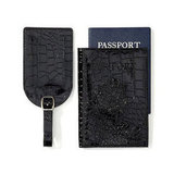 Is your mom the ultimate jet-setter? Give her this chic black faux-crocodile passport and luggage tag set ($20).