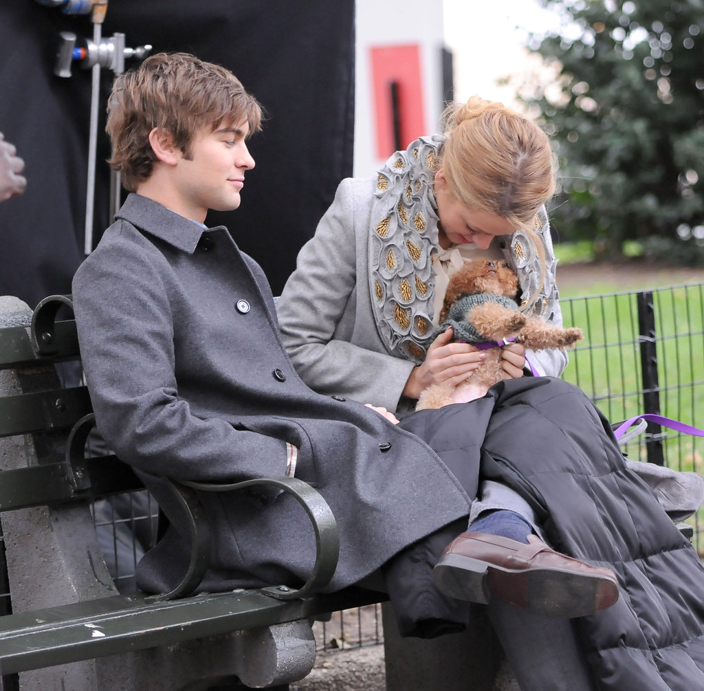 Blake Lively snuggled with her best friend Penny and chatted with Chace Crawford on set in October 2009.