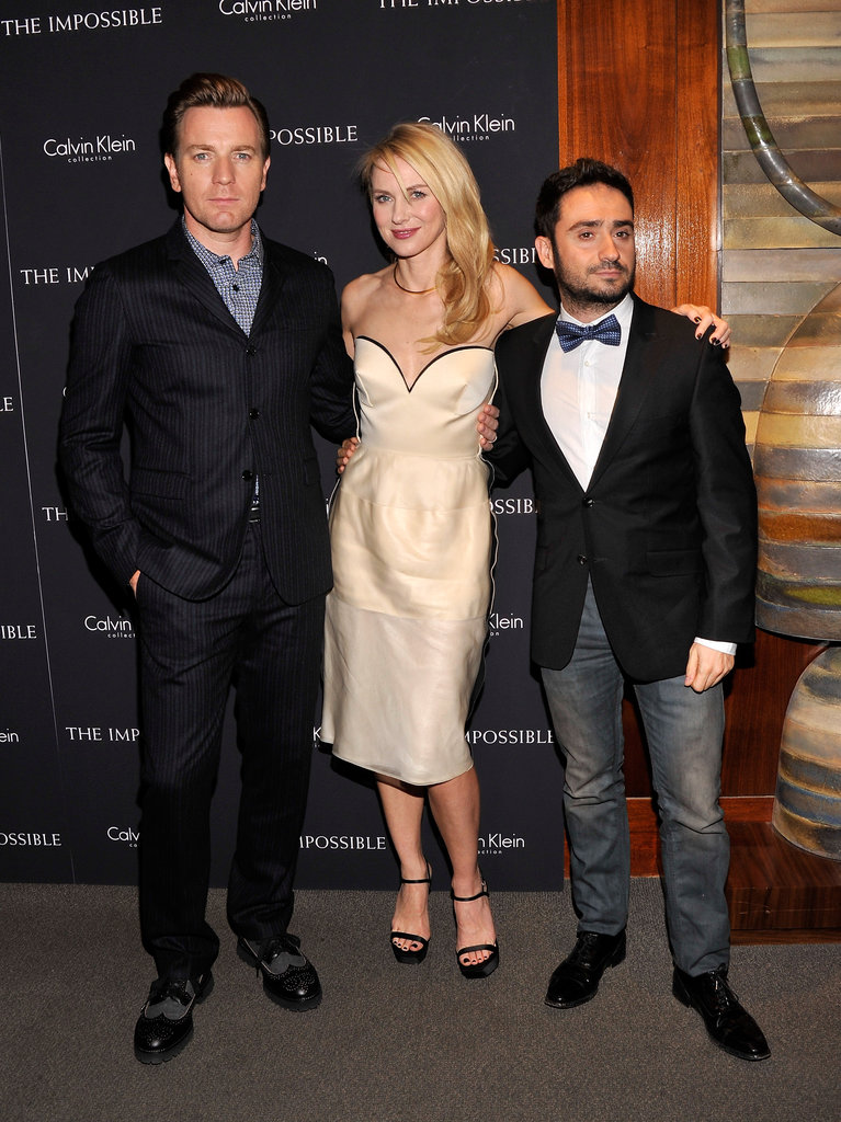 Ewan McGregor, Naomi Watts and J.A. Bayona — the stars and director of new movie The Impossible — stayed close together at a screening of the film in New York on December 12.