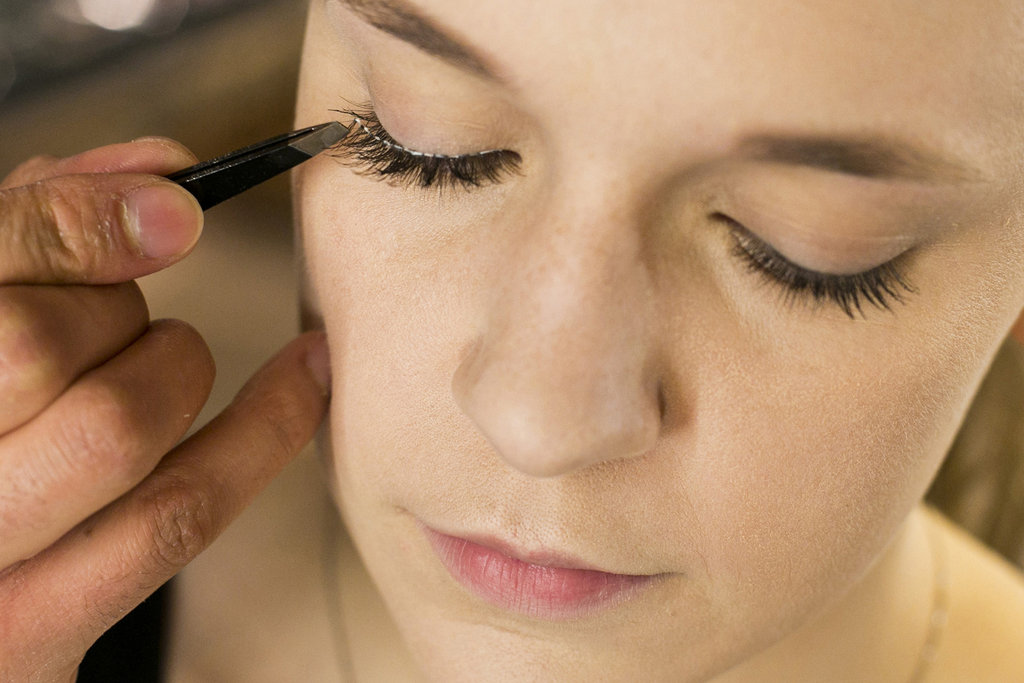 """Tweezers will help to really place the lash properly,"" Jennings says. ""You get more precision with the tweezers as opposed to your fingers."" Once you've placed the lashes, you can adjust them quickly while the glue is still a little tacky. Source: Caroline Voagen Nelson"
