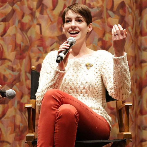 Anne Hathaway Wearing Red Jeans and Sweater