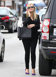 Reese Witherspoon paired purple pumps with her all-black ensemble.