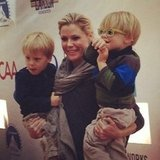 Julie Bowen balanced two of her adorable sons at the early-morning Milk and Bookies event.