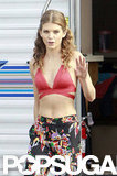 AnnaLynne McCord waved at photographers while wearing a red bikini top.