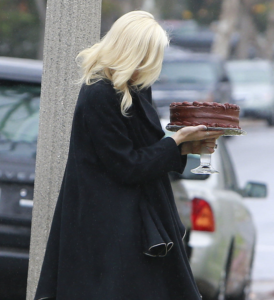 Gwen Stefani wore a black coat.