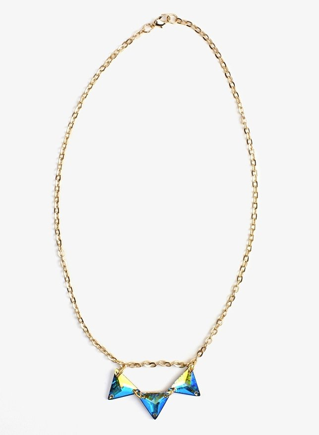 For just a splash of holographic shine, opt for something subtle: Nasty Gal's Hologram Crystal Necklace ($18) is a more low-key method for paying homage to Spring's burgeoning color trend.