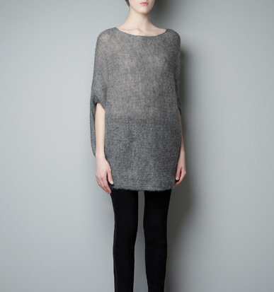 We love the idea of layering a slim black turtleneck under Zara's poncho sweater ($60) for extra warmth during the Winter.