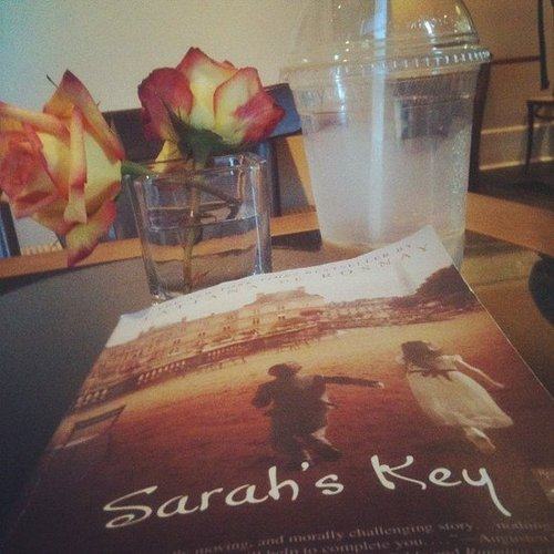 Instagram user ladouleurexquise7 had a perfect setup with flowers, coffee, and Sarah's Key.