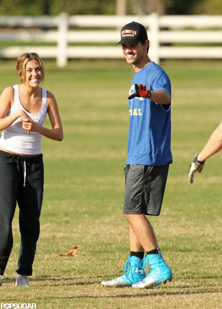 Taylor Lautner played football with a female friend.