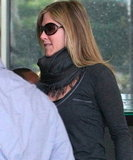 Jennifer Aniston wore sunglasses.