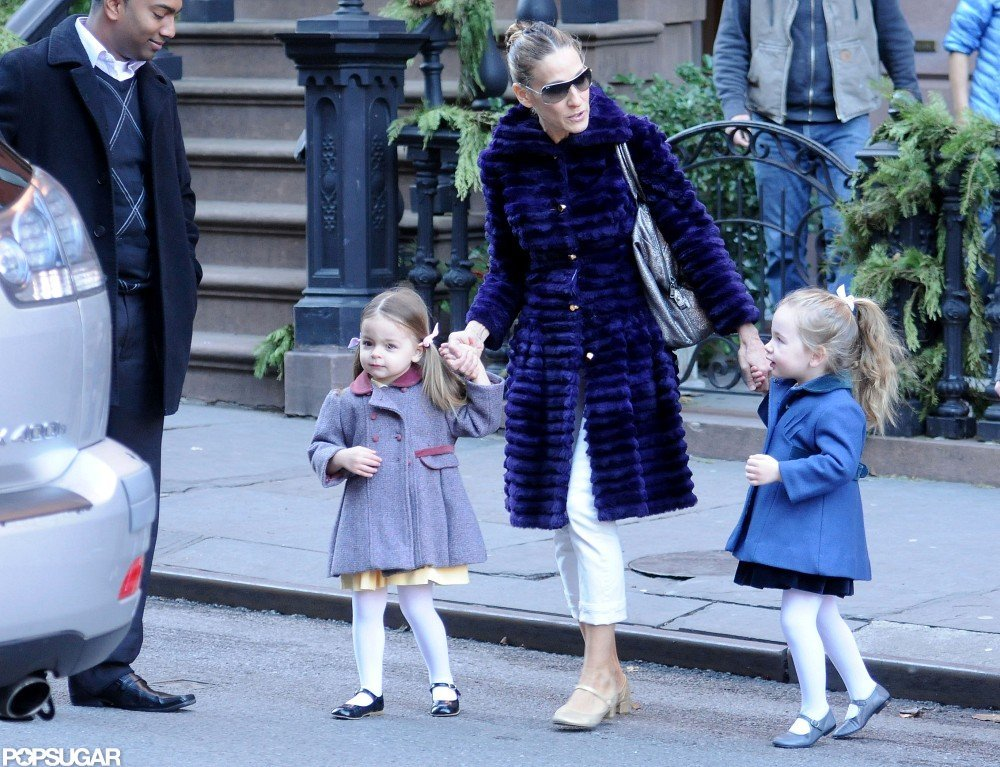 Sarah Jessica Parker's twin daughters wore fancy coats and white tights.