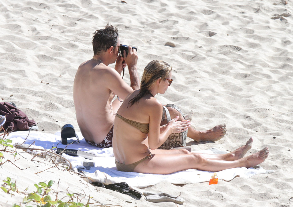 Kate Moss relaxed in a bikini while Jamie Hince took photos.