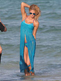 Erin Heatherton covered up her bikini with a blue cover-up.