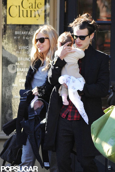 In October, Tom Sturridge doted on daughter Marlowe while walking through NYC with Sienna Miller.