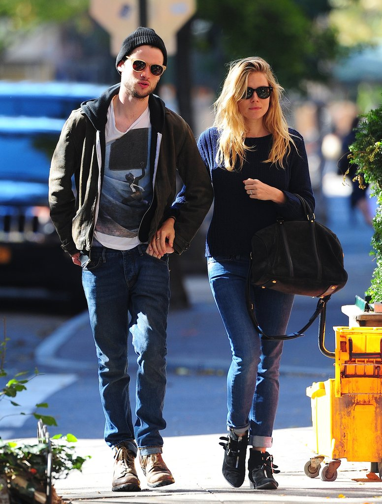 Sienna Miller walked arm in arm with Tom Sturridge in NYC in October.