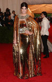 Bianca Brandolini D'Adda did not spare one glittery gold detail (in Dolce & Gabbana) at this year's Met Gala.