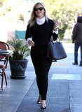 Reese Witherspoon wore a white shirt under a black sweater.