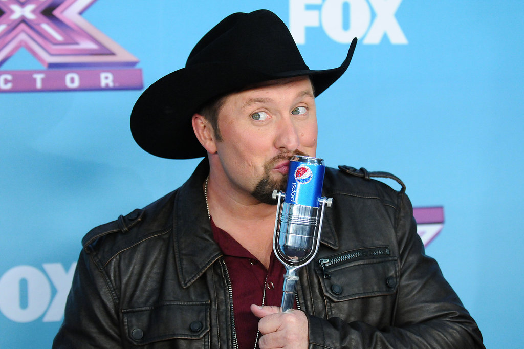 Tate Stevens posed with his trophy on the red carpet.