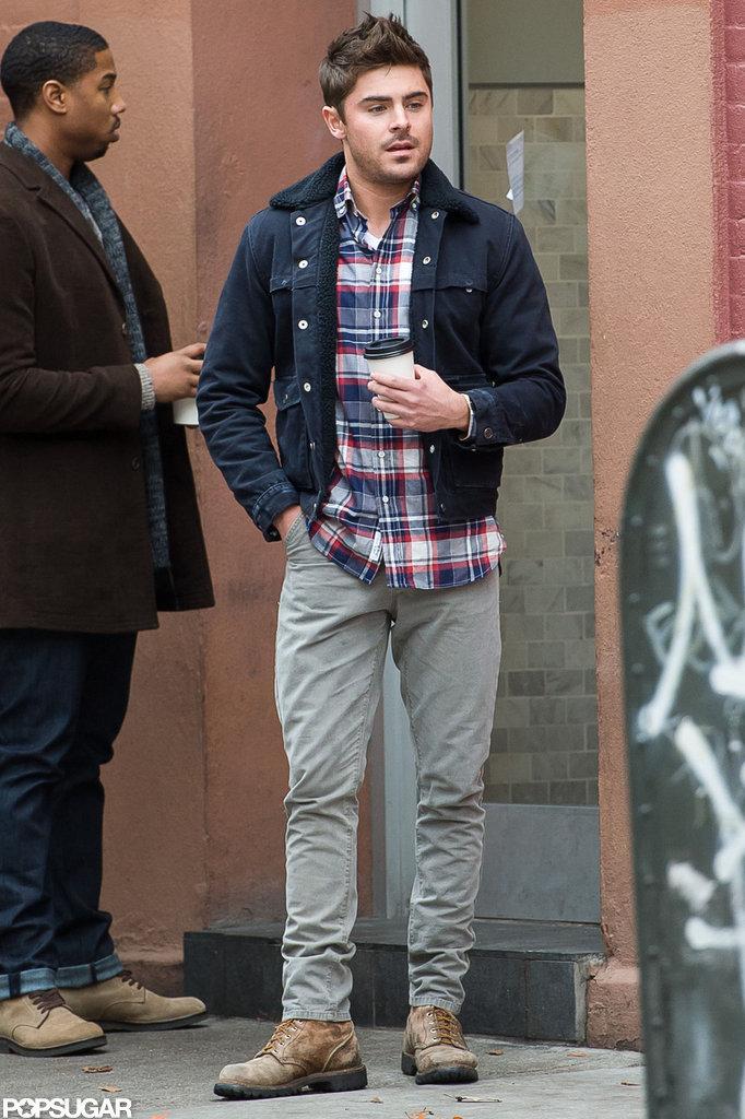 Zac Efron wore gray pants.