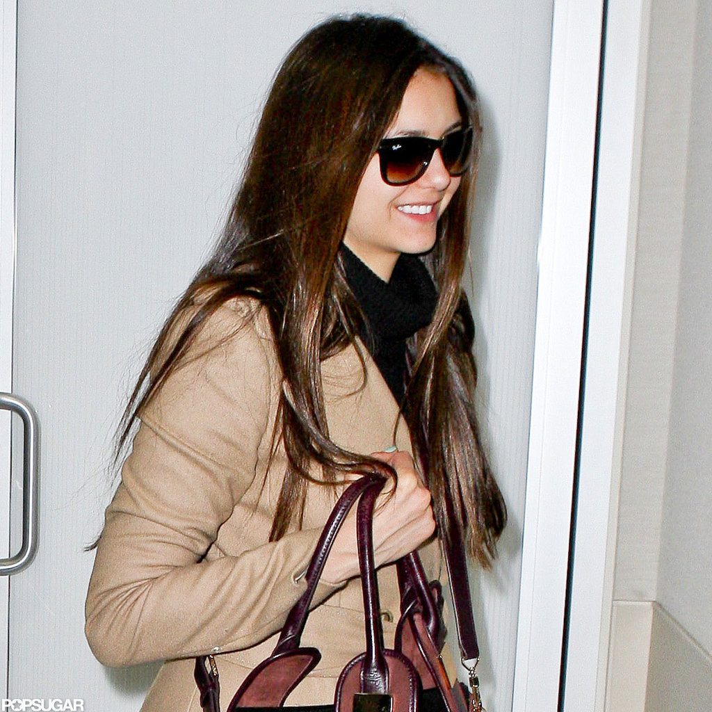 Nina Dobrev was all smiles upon her departure.