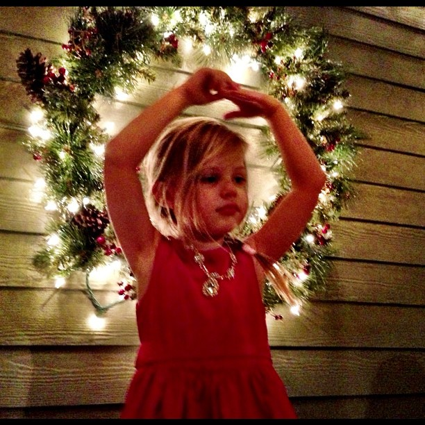 Busy Phillips snapped a photo of her daughter, Birdie, posing in front of a Christmas wreath. Source: Instagram user busyphillips
