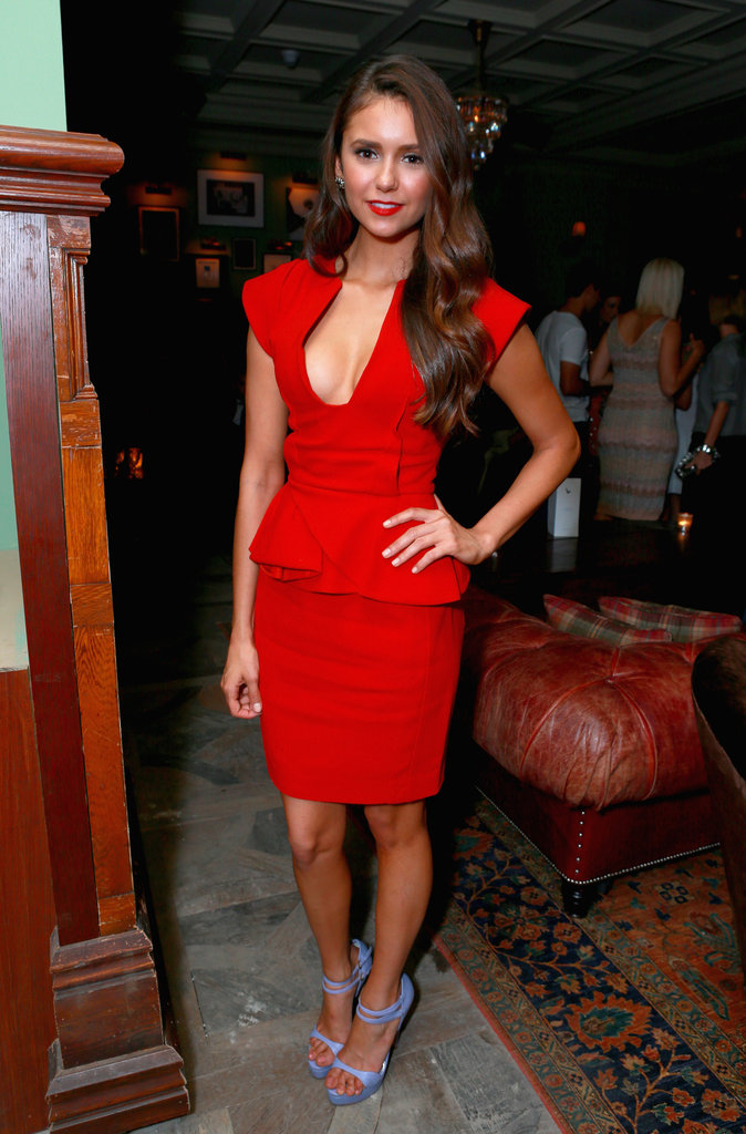 A sexier take for Nina in a red-hot Elie Saab number for the Argo premiere.