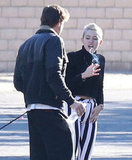 Miley Cyrus and Liam Hemsworth headed home from Palm Springs.