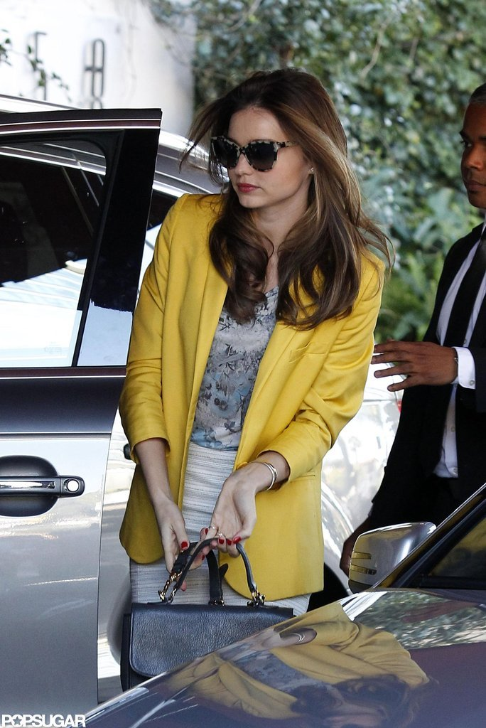 Miranda Kerr wore a yellow blazer.