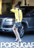 Miranda Kerr was dressed in a yellow blazer and miniskirt.