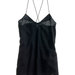 I love that this black Madewell silk cami ($72) blurs the line between what is strictly a pretty underthing and something that's classic and wearable. With its looser fit and sexy neckline paneling, I can already see that this camisole is perfect for layering for all seasons.