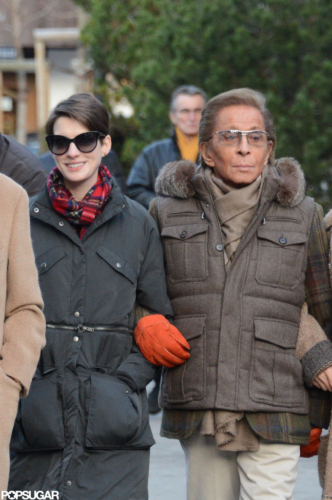 Anne Hathaway and Valentino kept warm.