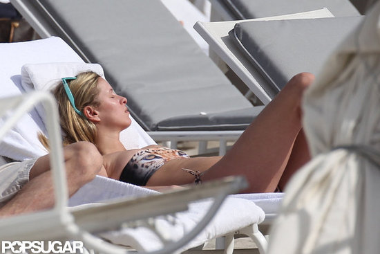 Nicky Hilton tanned herself on a chaise.