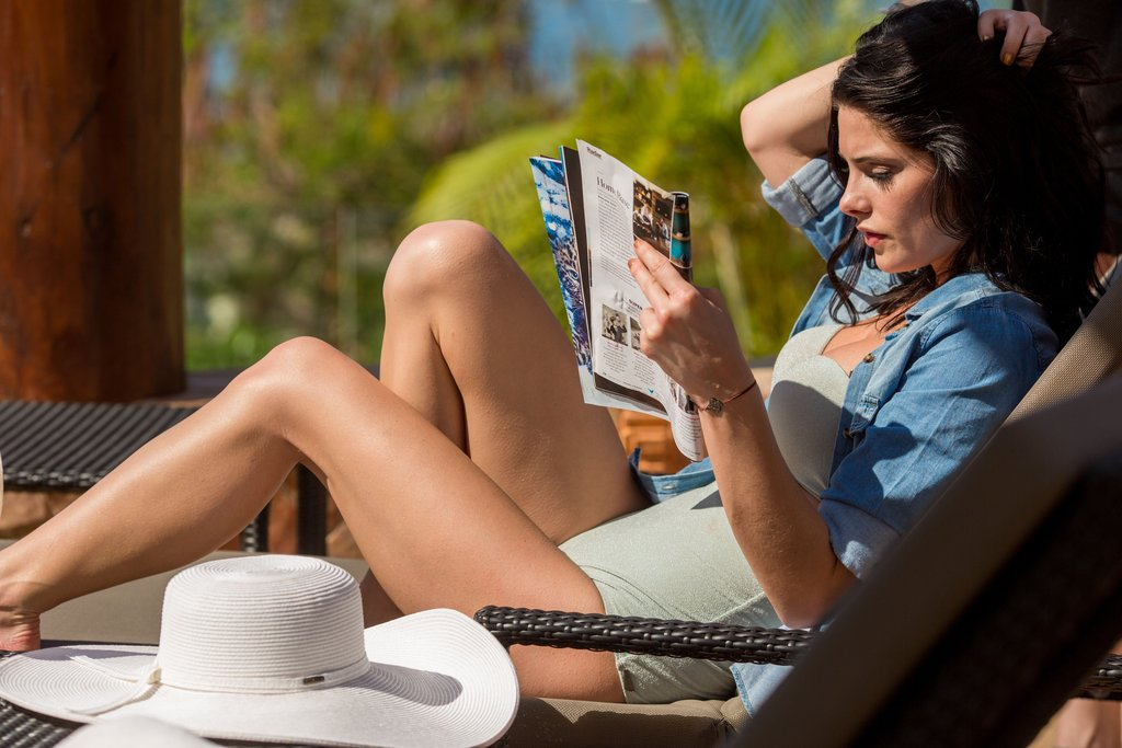 Ashley Greene read a magazine while relaxing in a bikini.