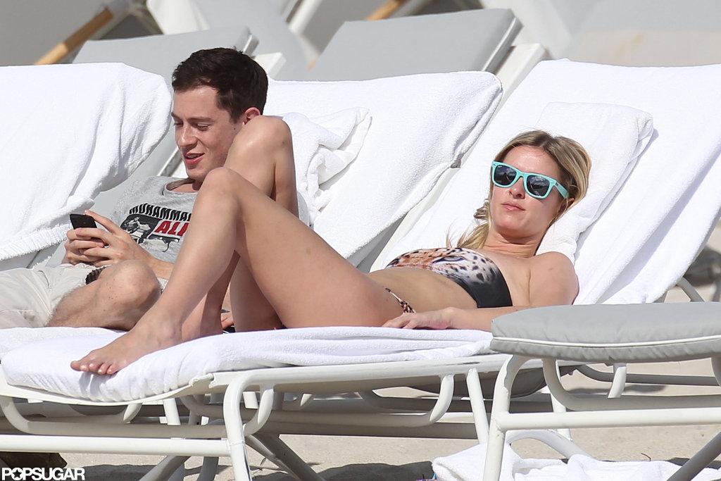 Nicky Hilton wore a bandeau bikini and blue sunglasses.