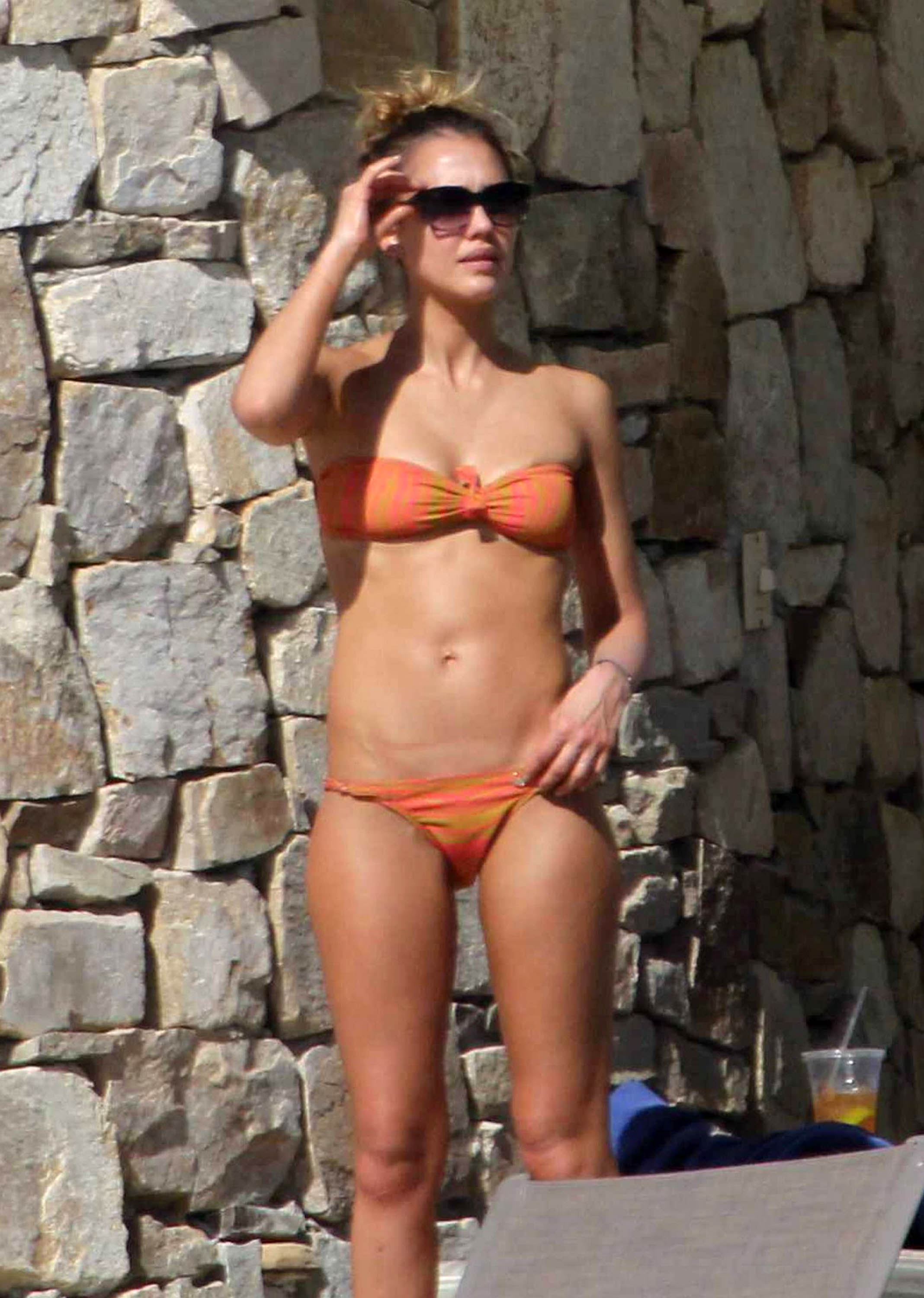 Jessica Alba sported a skimpy orange bikini while in Mexico with her family in January.
