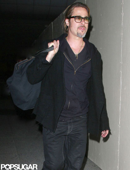 Brad Pitt touched down at LAX wearing all black.